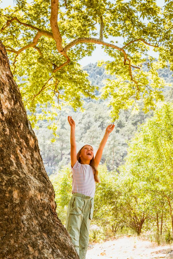 Little girl and big tree. Green life, ecology background royalty free stock images