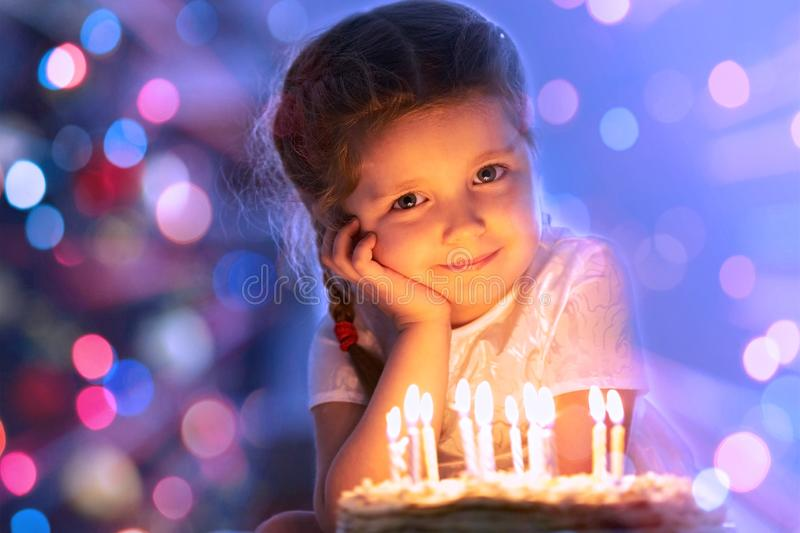 Little girl with birthday's cake stock images