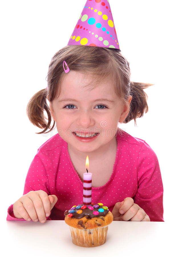 Little girl with birthday cake. Isolated on white background royalty free stock photo