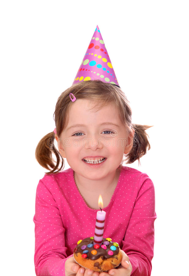 Little girl with birthday cake. Isolated on white background stock photography