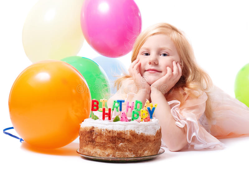 Little girl with birthday cake. Isolated on white stock photo
