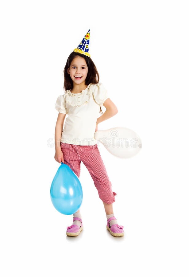 Little girl in birthday cap. Isolated on white stock photo