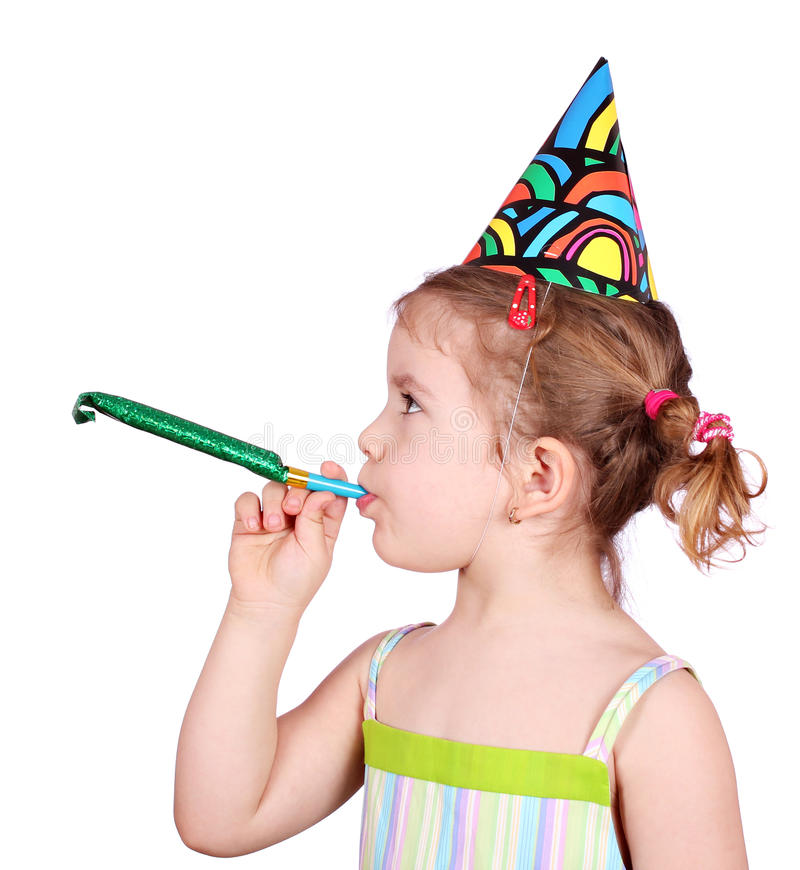Little girl with birthday hat and trumpet party. Studio shot stock photo