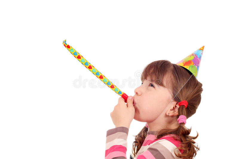 Little girl with birthday hat and trumpet. On white stock image
