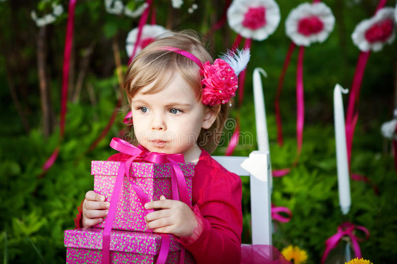 Little girl with birthday presents stock image