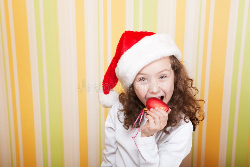 Download Little Girl Bites A Heart Royalty Free Stock Photo - Image: 11628345