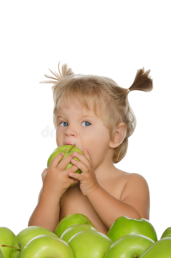 Little girl bitten green apple stock photo