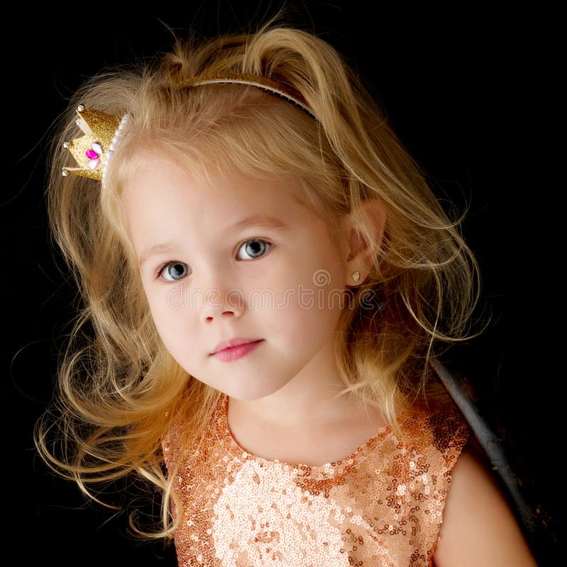 Little girl on a black background royalty free stock image