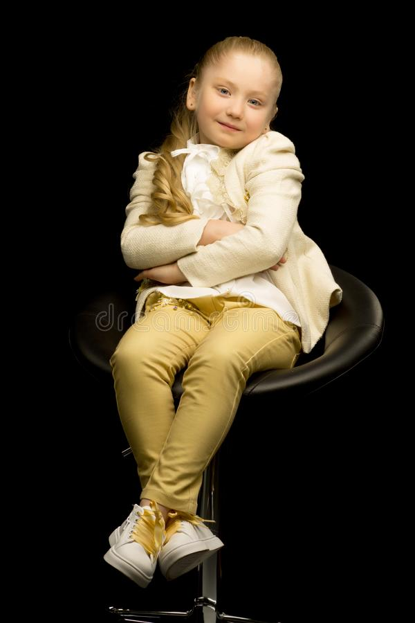 Little girl on a black background stock photos