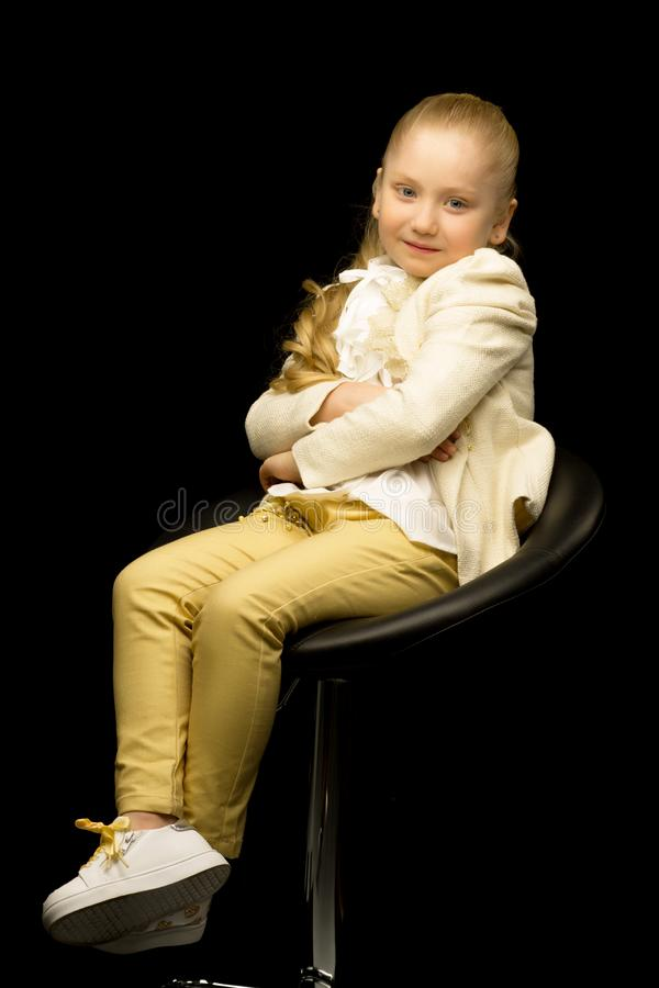 Little girl on a black background royalty free stock photography