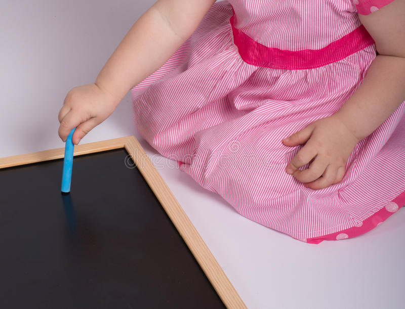 Little girl with blackboard stock images