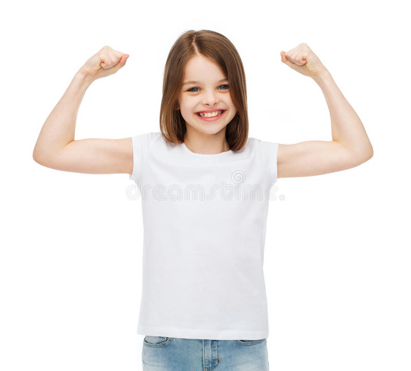 Little girl in blank white t-shirt showing muscles. Strength, health, sport, fitness concept - smiling teenage girl in blank white t-shirt showing muscles stock photos