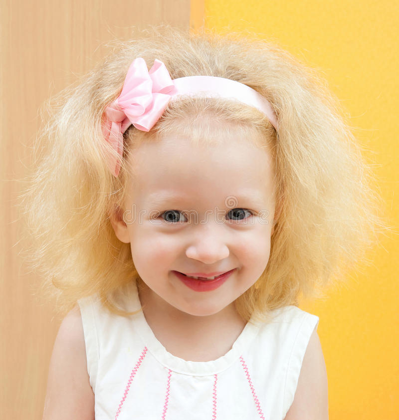 Little girl with blond hair stock image