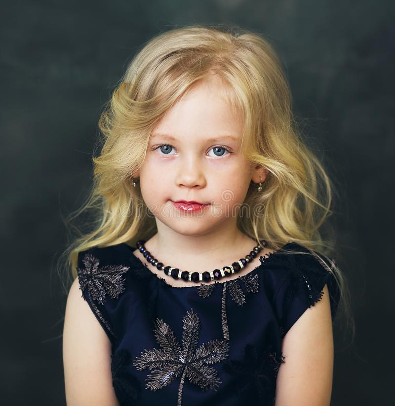Little girl with blond hair stock photo