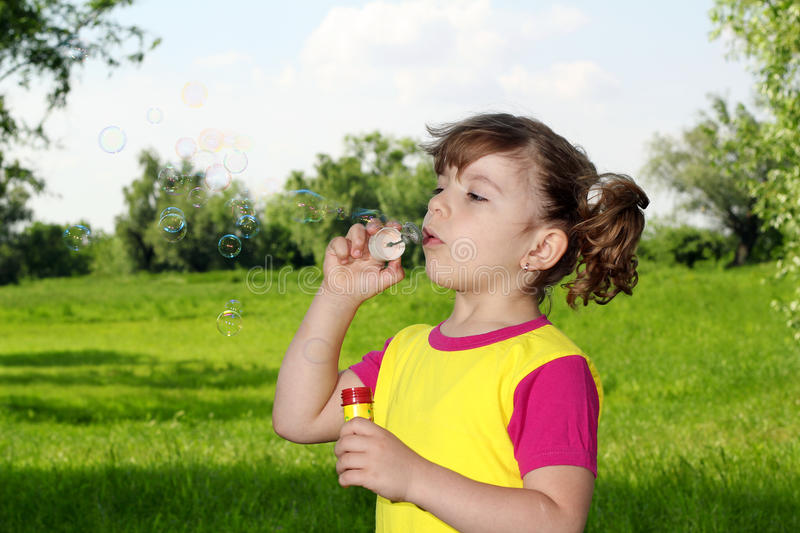 Download Little Girl Blowing Bubbles Stock Photo - Image: 25060730