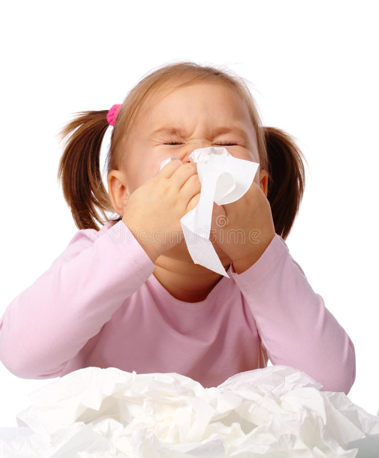 Little girl blows her nose stock photography