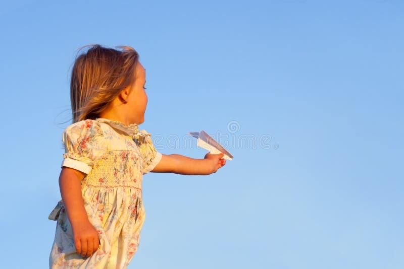 Little girl on blue stock photography