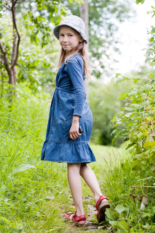 Little girl in blue dress royalty free stock photo