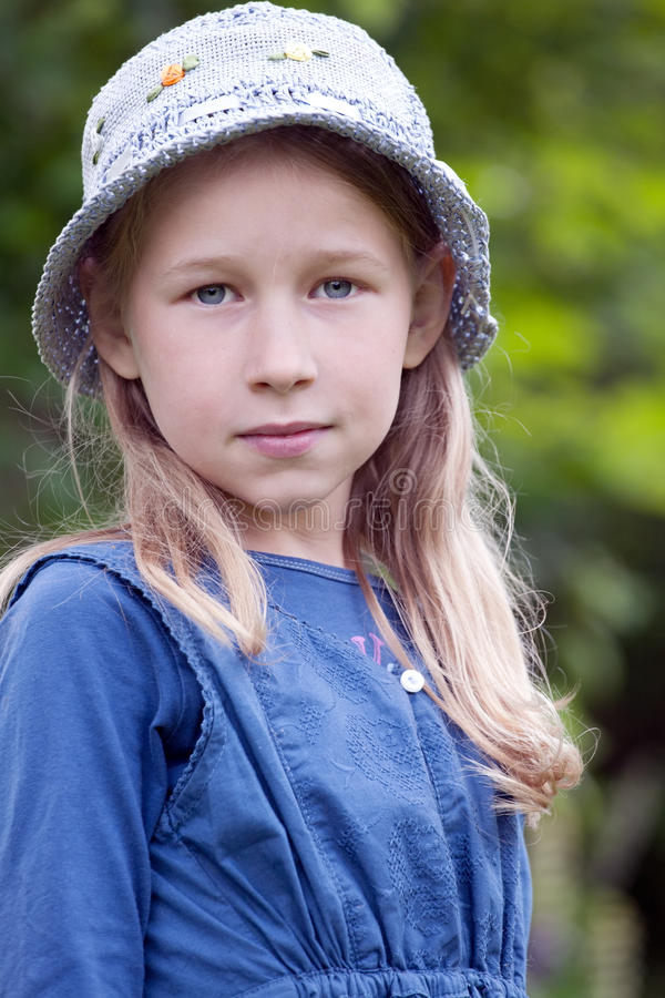 Little girl in blue hat stock images