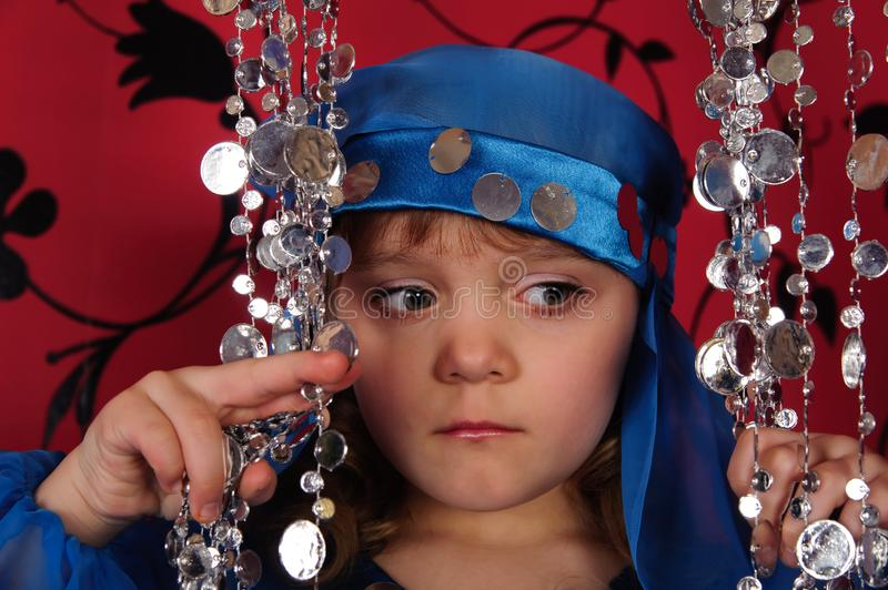 Little girl in blue oriental costume royalty free stock photos