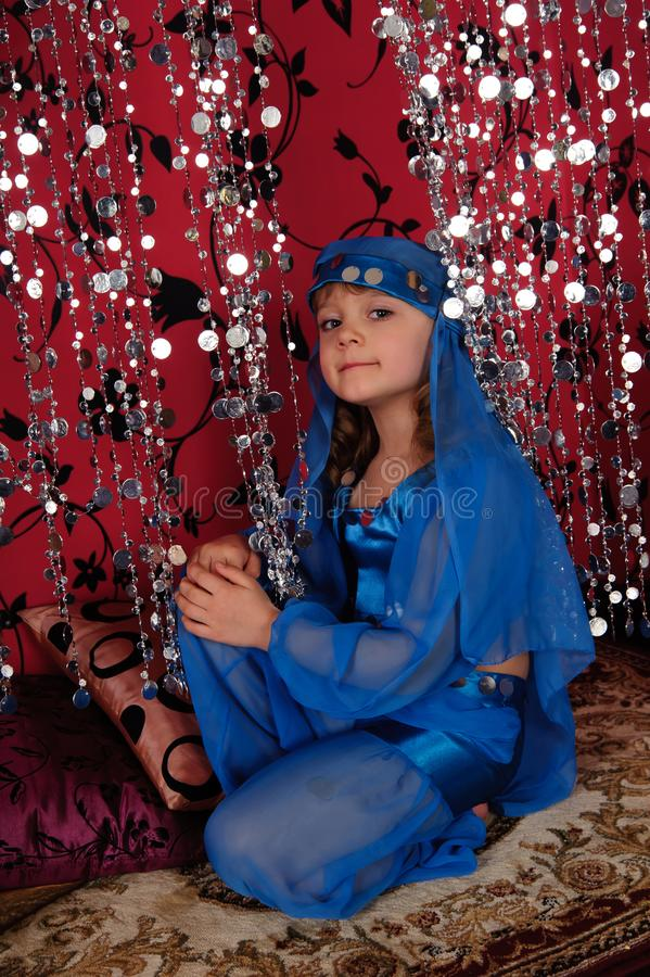 Little girl in blue oriental costume royalty free stock photo
