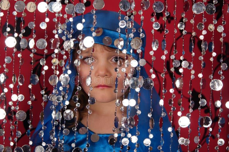 Little girl in blue oriental costume stock image