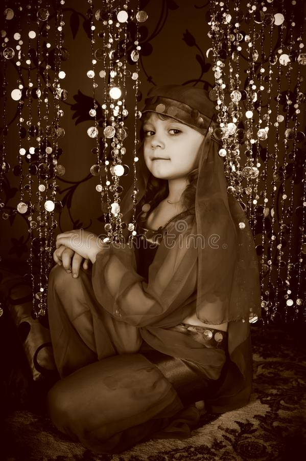 Little girl in blue oriental costume stock photos