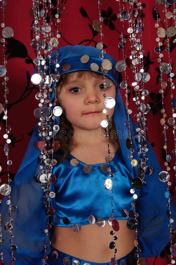 Little girl in blue oriental costume royalty free stock image