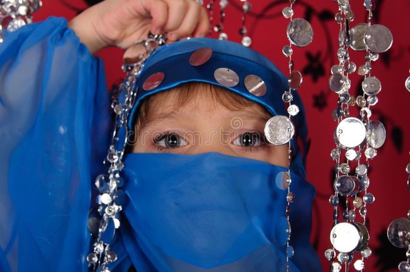 Little girl in blue oriental costume royalty free stock images