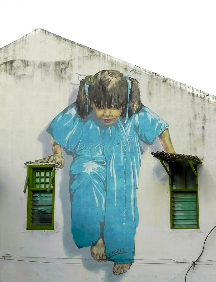 `Little girl in blue` painting on building walls, landmark of George town, Penang, Malaysia royalty free stock photo