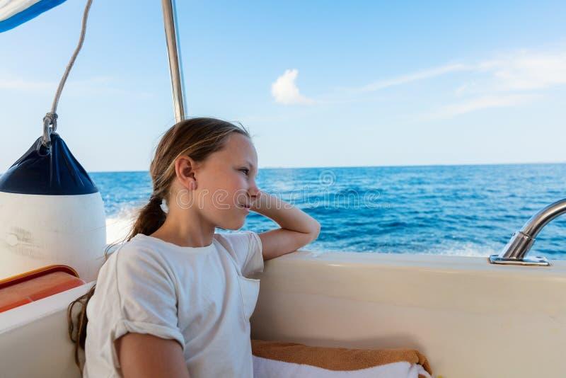 Little girl on boat. Adorable little girl on board of speedboat royalty free stock photo