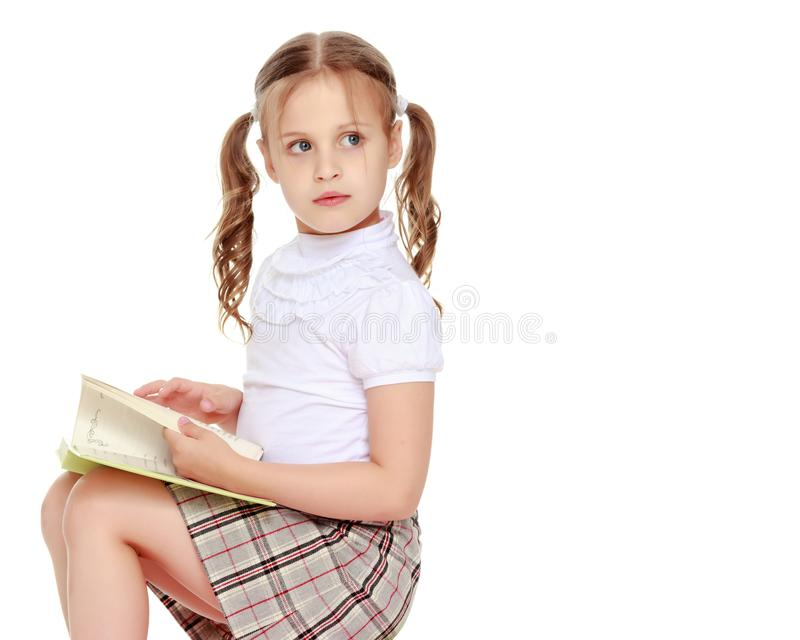 Little girl with a book stock photos
