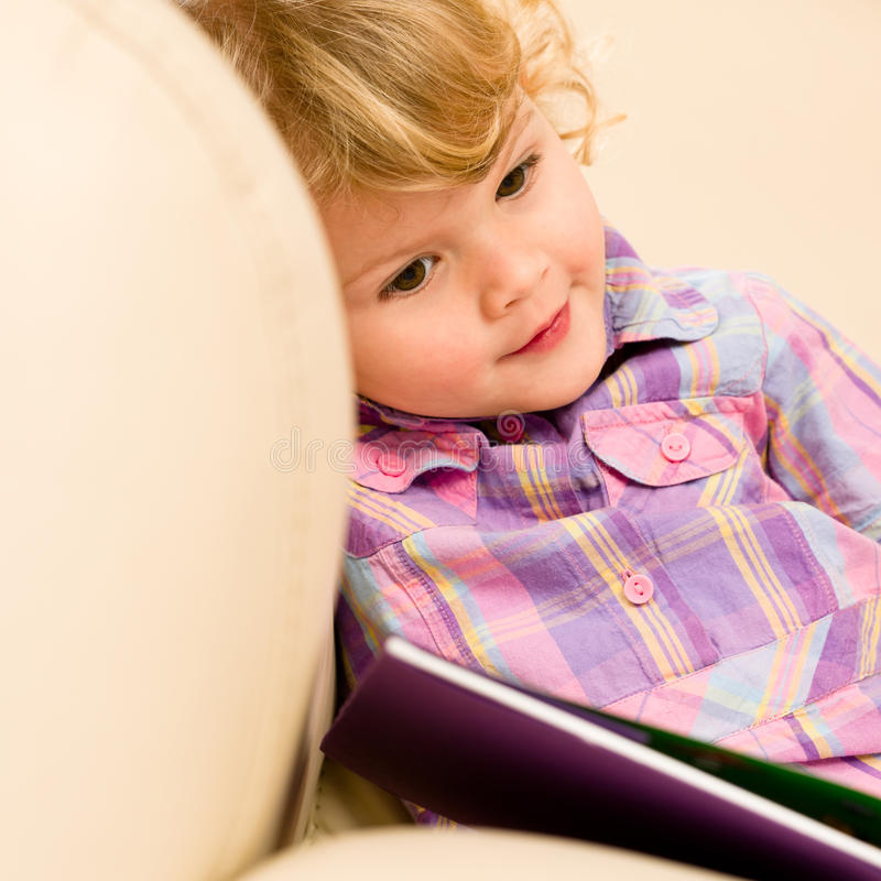 Download Little Girl With Book Looking At Pictures Royalty Free Stock Images - Image: 23459069
