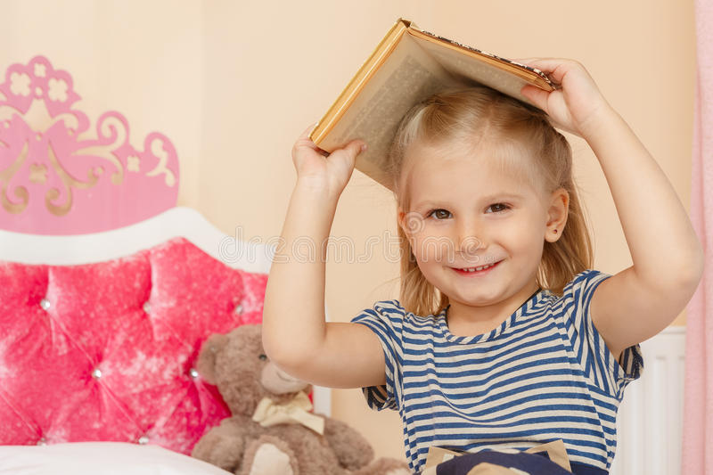 Little girl with a book stock images