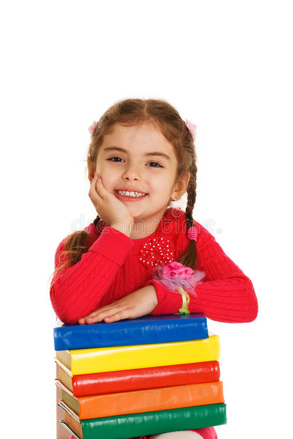 Little girl with books stock images