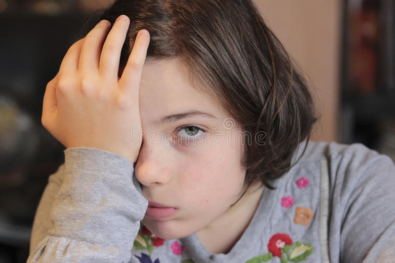 Little girl with a bored expression stock image