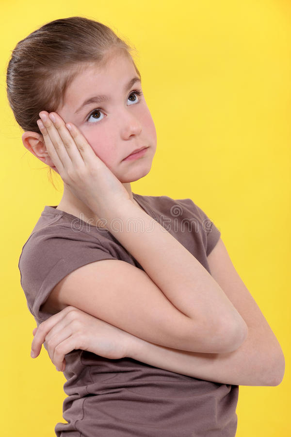 Little girl bored. Out of her head stock image
