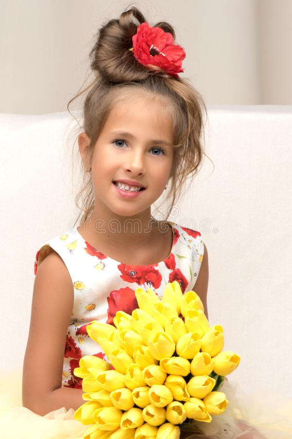 Little girl with a bouquet of flowers stock image