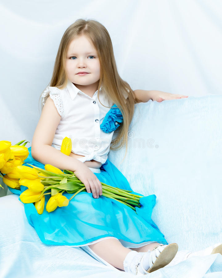 Download Little Girl With Bouquet Of Tulips Stock Photo - Image of happy, background: 91999152
