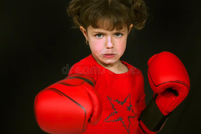 Little girl boxing royalty free stock photos