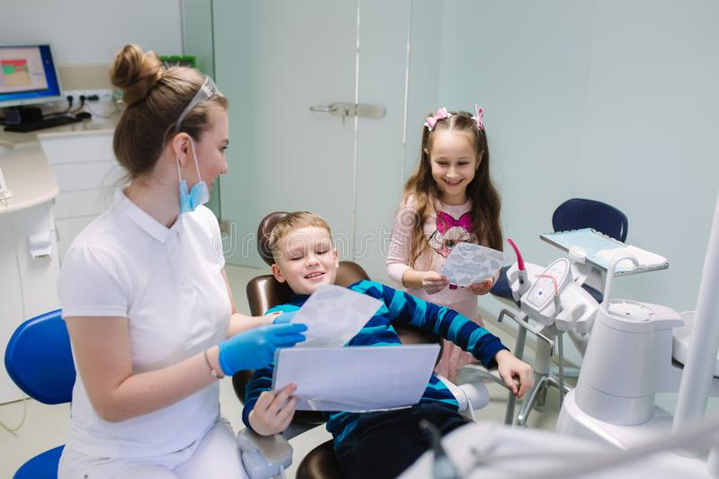 Little girl and boy in dentist. happy children royalty free stock image