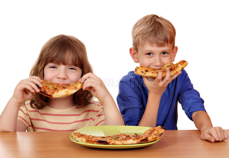 Little girl and boy eat pizza. Happy little girl and boy eat pizza royalty free stock image