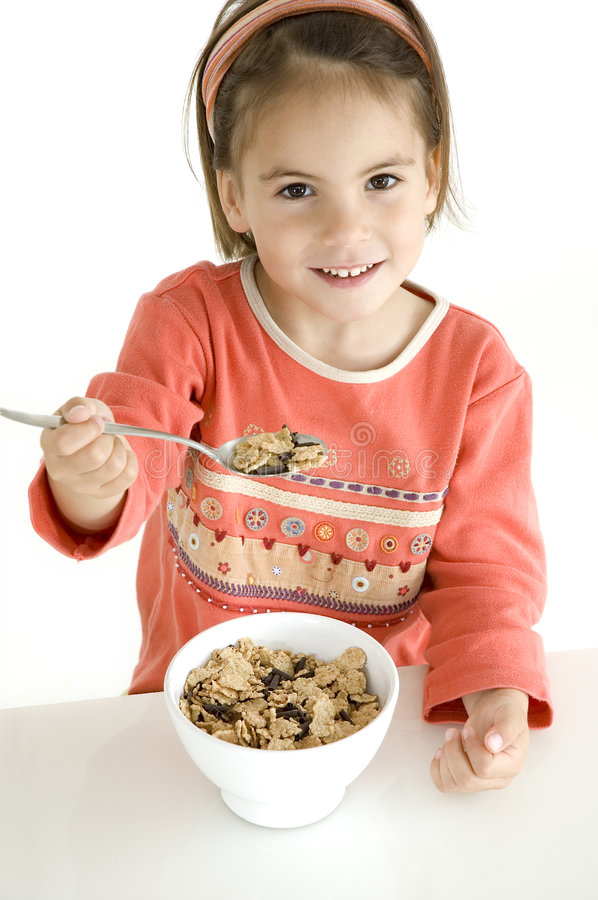 Little girl with breakfast royalty free stock image