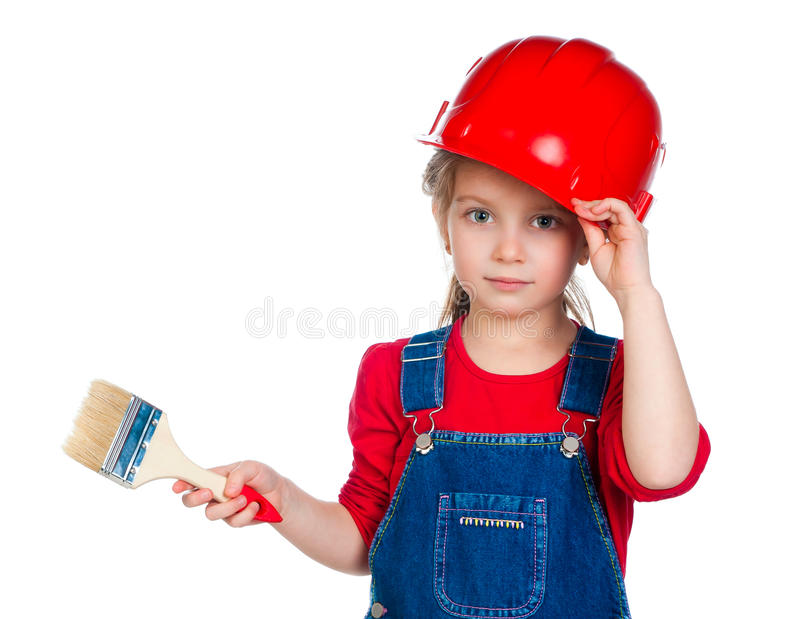 Little girl with a brush. Pretty little girl with a brush in a red helmet royalty free stock images