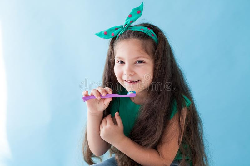 Little girl brushing his teeth with a toothbrush dent. Little girl brushing his teeth with a toothbrush stock photo