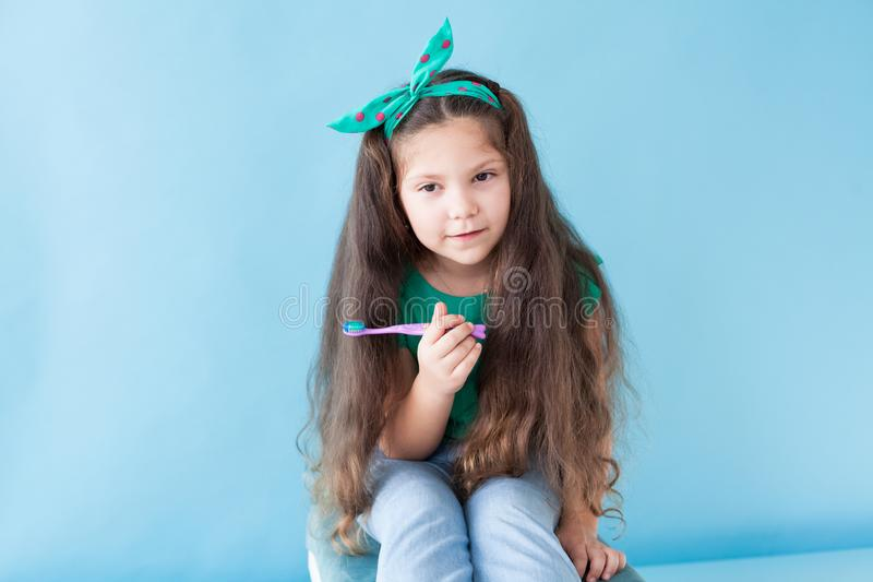 Little girl brushing his teeth with a toothbrush dent. Little girl brushing his teeth with a toothbrush royalty free stock images