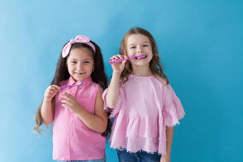 Little girl brushing his teeth with a toothbrush dent. Little girl brushing his teeth with a toothbrush stock image