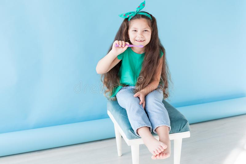 Little girl brushing his teeth with a toothbrush dentistry tooth stock image
