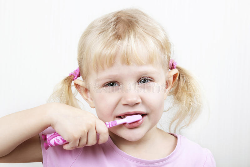 Download Little girl brushing teeth stock photo. Image of toothbrush - 12724142