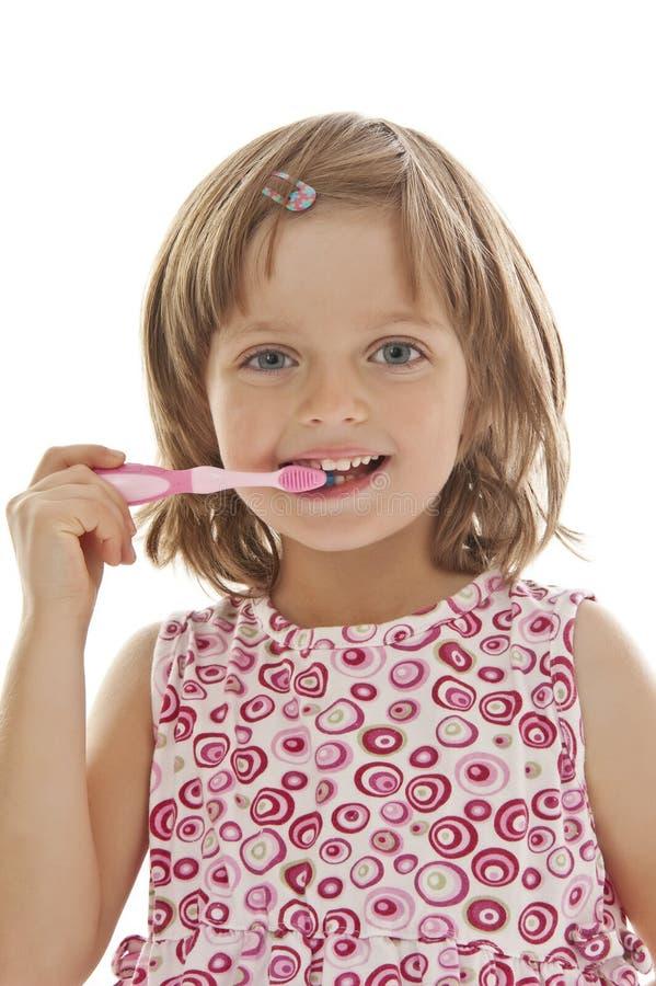 Download Little girl brushing teeth stock image. Image of child - 21878587